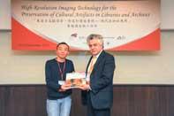 Mr. HUANG Chen Present Souvenirs to Prof. Ari Ide-Ektessabi