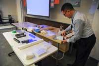 Mr. Naoharu Usami preparing preservation demonstration