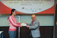 Mr. Chijo Onishi  Present Certificate to Ms. LV Shuxian
