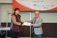 Mr. Chijo Onishi  Present Certificate to Ms. YANG Lulu