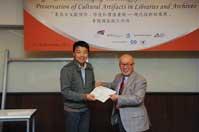 Mr. Chijo Onishi  Present Certificate to Mr. WANG Xin