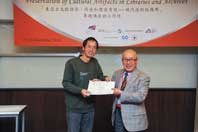 Mr. Chijo Onishi  Present Certificate to Mr. XIAO Xiaobo