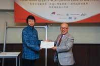 Mr. Chijo Onishi  Present Certificate to Ms. WANG Xiaolei
