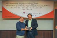 Prof. Steve Ching Present Souvenirs to Dr. Jay Arre Oliveros Toque